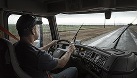 a person sitting at the dash of a Volvo truck
